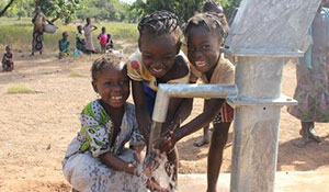 Missionaries help build well for clean water.